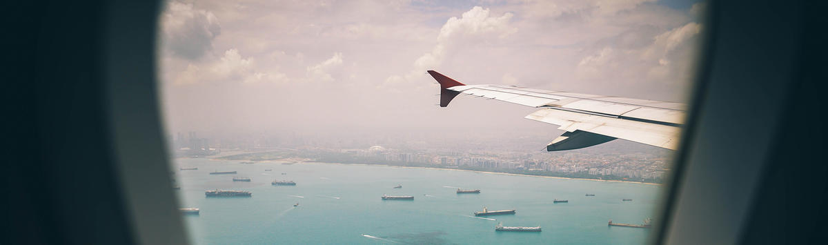 View from airplane with wing and water below