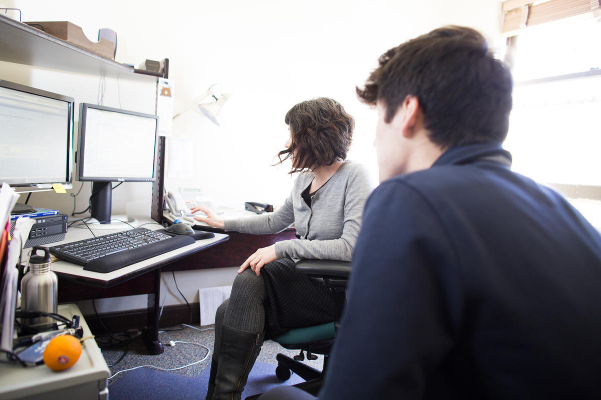 An international student adviser works with a student at Berkeley International Office
